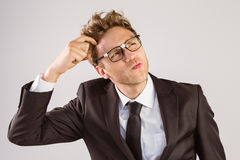 Young geeky businessman scratching his head Stock Photos