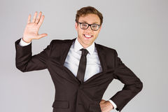 Young geeky businessman smiling at camera Royalty Free Stock Images