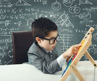 Young genius. Concept of young genius that works with abacus Stock Photo