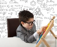 Young genius. Concept of young genius that works with abacus royalty free stock photography