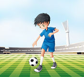 A young gentleman playing soccer Royalty Free Stock Photo