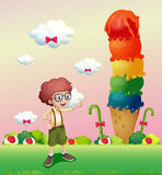 A young gentleman standing near the giant icecream Stock Photo