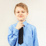 Young gentleman tying tie over bright shirt Stock Photography