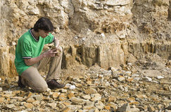 Young geologist studying rock type Stock Images