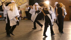 Young German dancers in traditional costume perform one funny folk dance