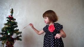 Young german girl celebrates Christmas holding Bengali flame. stock video footage
