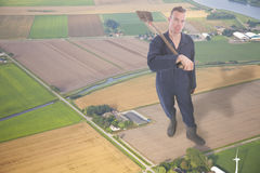 Young giant farmer in aerial view of dutch farmer landscape Royalty Free Stock Photos