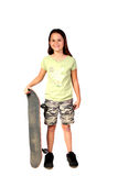 Young girl 1. Young girl wearing camouflage and holding her skateboard Royalty Free Stock Photo
