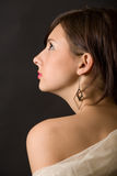 Young girl. Profile over black Royalty Free Stock Photos