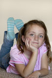 Young Girl. Leaning on hands thinking Royalty Free Stock Images