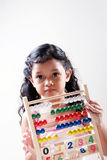 Young girl. A young Asian girl with maths instrument Royalty Free Stock Images