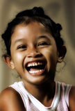 Young girl. A young Asian girl laughing Royalty Free Stock Photos