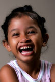 Young girl. A young Asian girl laughing Stock Photo