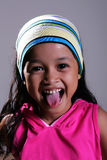 Young girl. A young Asian girl laughing Stock Image