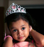 Young girl. A young Asian girl wearing crown smiles Stock Image