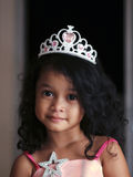 Young girl. A young Asian girl wearing crown smiles Royalty Free Stock Photos