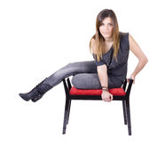 Young girl. A young beautiful woman on a red chair Stock Images