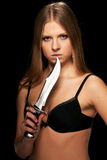 The young girl. With a dagger Stock Photography