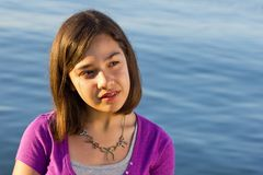 Young girl. A young girl with braces posing at the beach Royalty Free Stock Images