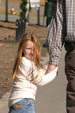 Young Girl. Holding her father's hand while they walk Royalty Free Stock Photo