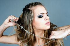 Young girl. A girl rids of the barbed wire Stock Photos