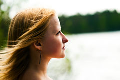 Young Girl. Looking up at the sky on the banks of the River Stock Images