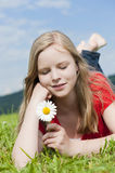 Young girl. Lying in a meadow royalty free stock photos