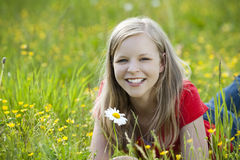 Young girl. Lying in a meadow stock images