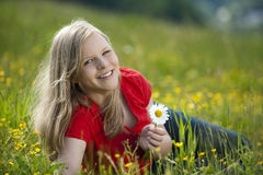 Young girl. Lying in a meadow royalty free stock image
