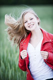 Young girl. Happy young girl in the nature royalty free stock image