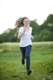 Young girl. Happy young girl in the nature royalty free stock photography
