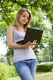 Young girl. With her laptop Royalty Free Stock Image