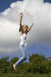 Young girl. Jumping in air Stock Photos
