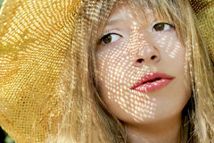 A young girl. A young girl with an earring in his nose and a hat in the summer weather royalty free stock photo