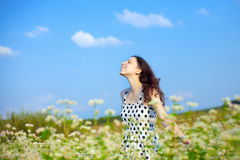 Young girl. Young happy girl walking on the buckwheat field royalty free stock photo