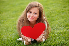 Young girl. Happy young girl holding red heart on Valentines Day Stock Photo