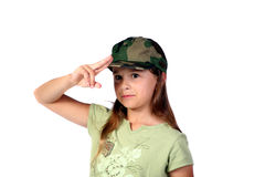 Young girl 3. Young girl pretending to be an army recruit while standing at attention Royalty Free Stock Photo