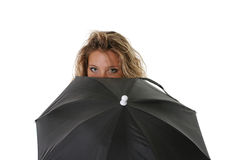 Young girl. The isolated beautiful girl holds a black umbrella Stock Photos