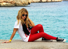 Young girl. With sunglasses near the sea in Majorca Royalty Free Stock Photo