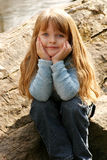 Young girl. Posing on a rock for a portrait Royalty Free Stock Photos