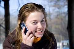 Young girl. Pretty girl talking on the phone stock photo