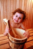 Young girl. Girl relaxing in finnish type wooden sauna stock photos