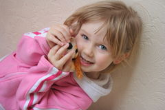 Young girl. Sweet child with her toy Stock Photos