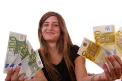 Young girl. Smiling and showing a large amount of money Stock Photos