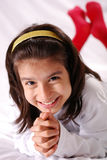 Young girl. Smiling young girl with white polo and red sox Royalty Free Stock Photos
