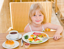 Young girl. Eating in restaurant Stock Photography