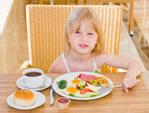 Young girl. Eating in restaurant Royalty Free Stock Image