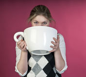 Young Girl About To Drink From Extra Large Cup Royalty Free Stock Photos