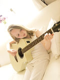 Young Girl on a Acoustic Guitar 3. Young Girl on a White Acoustic Guitar Stock Photography