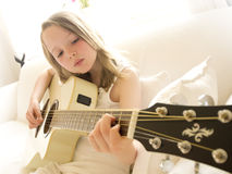 Young Girl on a Acoustic Guitar 4. Young Girl on a White Acoustic Guitar Royalty Free Stock Photos